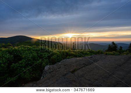 Sun Burst In Sunset Over Roan Highlands In Summer