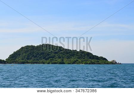 Beautiful Green Island Against Blue Sky On Sunny Day