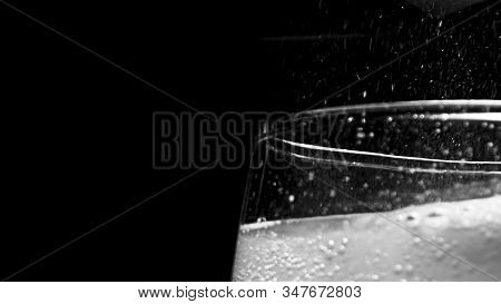 Glass With Hissing Carbonated Bubbles. Stock Footage. Close-up Of Carbonated Foam Bubbling And Sizzl