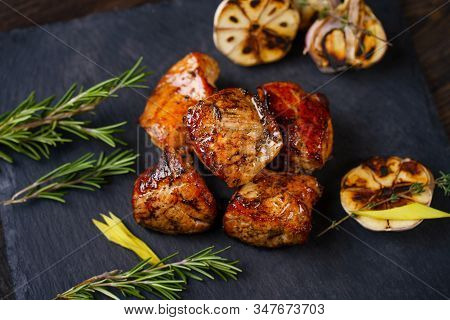 Grilled Pork Meat Served On Slate, Grill And Barbeque, Restaurant Menu. Delicious Food For Meat Love