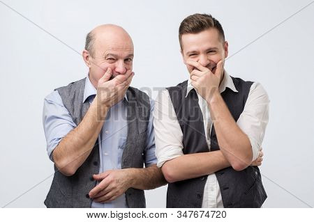 Two Caucasian Men Laughing On His Friends Joke