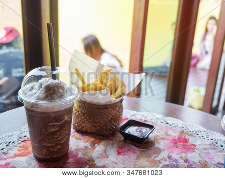 Mocha Frappe With French Fried On Table