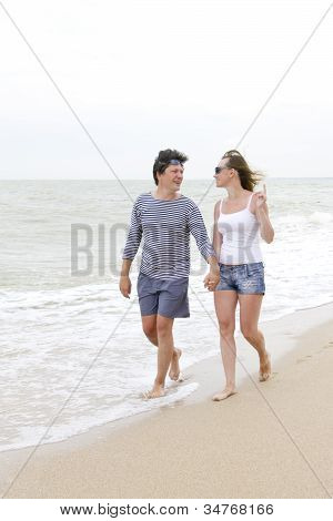 Happy Couple Enjoying Together At The Beach