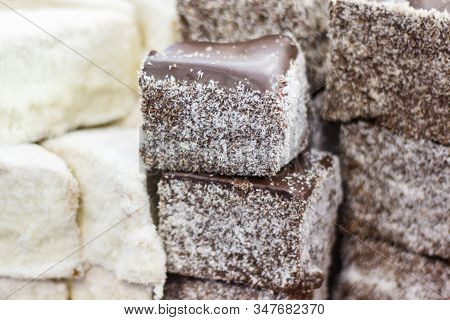 Pieces Of Fresh Baked Homemade Cake With Icing, Chocolate And Desiccated Coconut