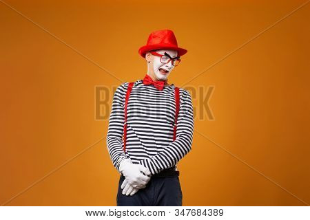 Sad mime man in vest and red hat Isolated