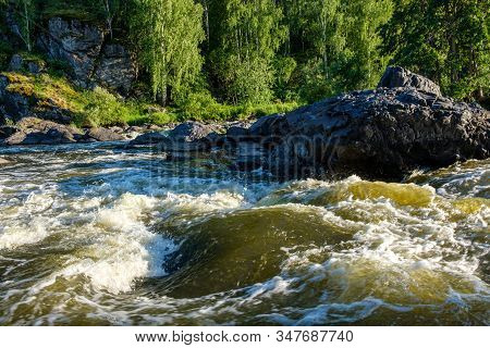 Rapid River Flows Of Water With Splashes Rapids On The River