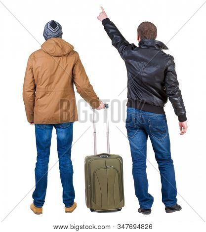 Back view of two man in winter jacket traveling with suitcas. Back view. Rear view people collection. backside view of person. Isolated over white background.