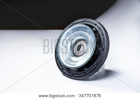 New Thrust Bearing Of Front Suspension Strut Of A Car On A Gray Background. The Concept Of New Spare