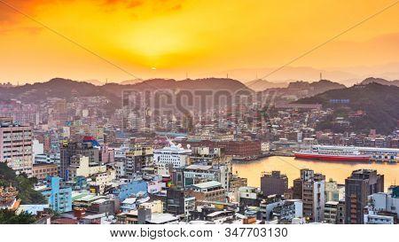 Keelung, Taiwan downtown city skyline on the bay at dusk.