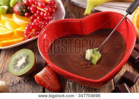 gourmet chocolate fondue with various fruit- valentines day concept