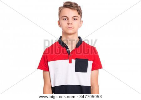Handsome teen boy isolated on white background. Photo of adorable young child looking at camera, front view. Emotional portrait of caucasian teenager.