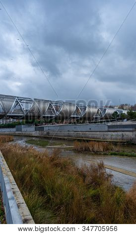 Views Of The Arganzuela Bridge In Madrid's Rio Park, On A Cloudy Day, Created By French Architect Do