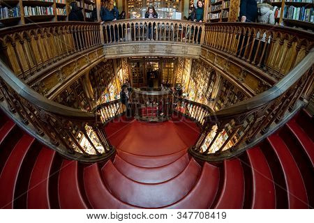 Porto, Portugal - January 20, 2020: Crowds Of Tourists Visit The Famous Bookstore Of Livraria Lello