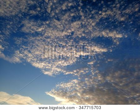Blurry Background. Blue Sky Background. Morning Sun Light And Beautiful White Clouds Formation. Brig