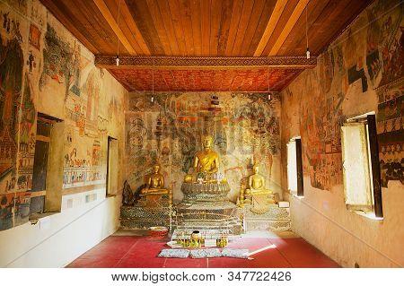 Luang Prabang, Laos - April 16, 2012: Buddha Statues And Interior Of The Wat Pa Huak Temple In Luang