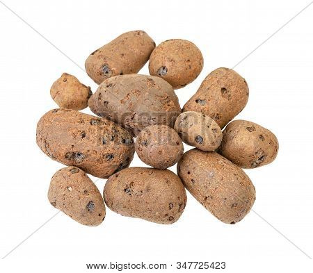 Top View Of Pile Of Lightweight Expanded Clay Aggregate Isolated On White Background
