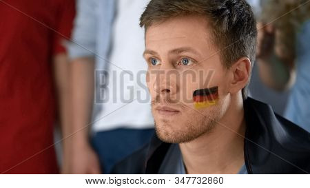 Upset German Football Fan Disappointed With Defeat, Watching Game With Friends