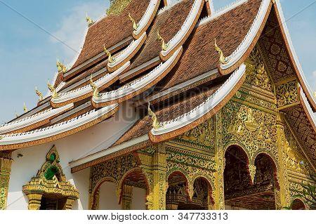 Luang Prabang, Laos - April 16, 2012: Roof And Facade Wall Decoration Of The Haw Pha Bang Buddhist T
