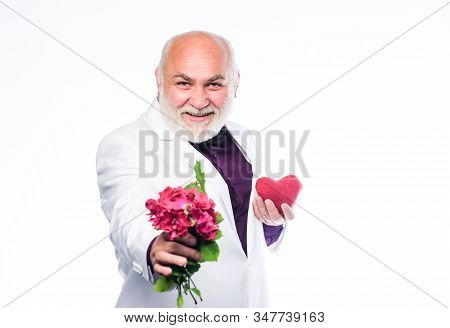 This Is For You. Senior Gentleman Romantic. Man Hold Heart Symbol Of Love. Gentleman Concept. True G