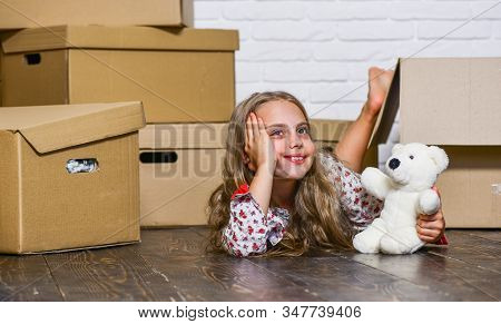 Girl Small Child And Boxes. Move Out Concept. Kid Moving Out. Moving Routine. Packaging Things. Prep