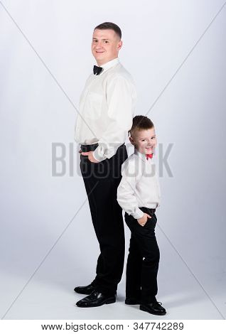 Dad And Boy White Shirts With Bow Ties. Gentleman Upbringing. Little Son Following Fathers Example O