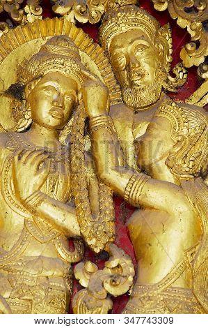 Luang Prabang, Laos - April 16, 2012: Detail Of The Ancient Golden Exterior Wall Decoration At Wat X