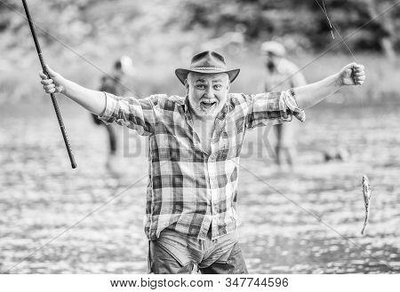 Fish Farming Pisciculture Raising Fish Commercially. Pensioner Leisure. Fish On Hook. Man Senior Fis