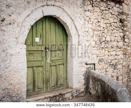 Closed Wooden Door And Stone Wall In Berat, Albania