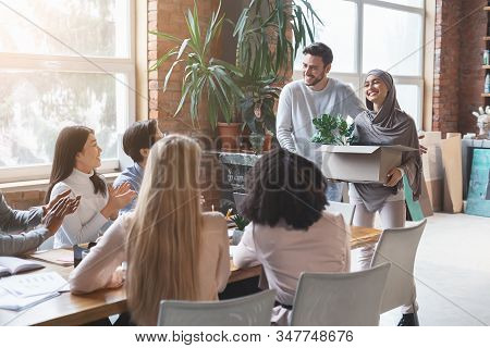 Friendly Young Multiracial Business Team Welcoming Girl In Hijab New Employee, Manager Introducing H