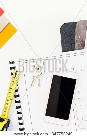 Creative Flat Lay Overhead Top View Blueprint Flat Project Plan And Mobile Smartphone Office Supplie