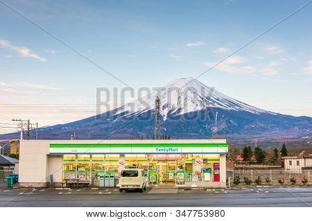 FUJIKAWAGUCHIKO, YAMANASHI, JAPAN - APRIL 12, 2017: FamilyMart convenience store under Mt. Fuji. FamilyMart is the second largest convenience store company in Japan.