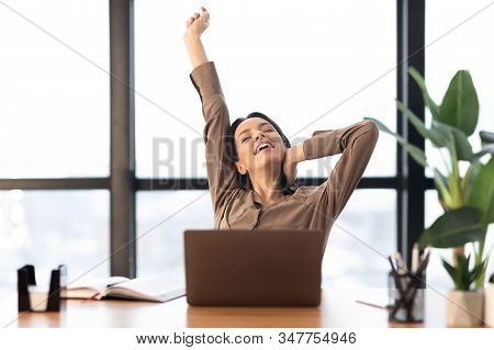 Stiff Neck Exercises. Happy Freelancer Stretching Body Working At Home Or Modern Office, Copyspace