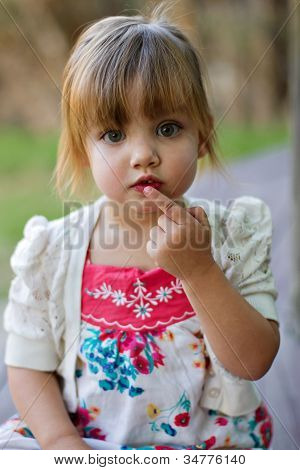 Outdoor location portrait of toddler