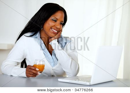 Lovely Student Girl Smiling And Looking To Laptop