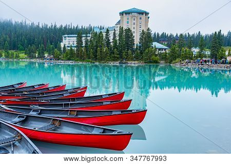 Canoes Docked In Front Of Popular Hotel Around Lake Louise