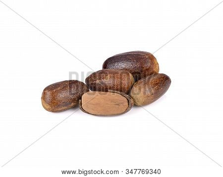 Whole Dried Nutmeg With Shell On White Background