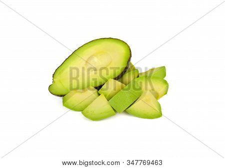 Whole And Cut Pieces Ripe Avocado On White Background