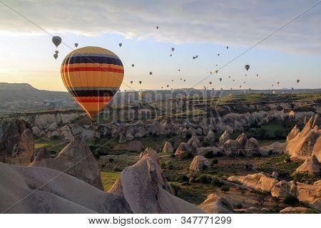 Air Baloons Flying At Sunrise In Cappadocia