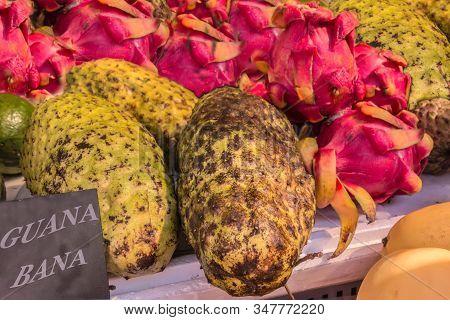 Fresh And Ripe Exotic Tropical Fruits Guanabana And Dragon Fruit (pitaya) On Traditional Farmer Mark