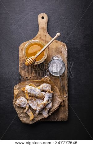 Composition Of Faworki - Angel Wings, Powdered Sugar And Honey On The Cutting Board, On The Stony Co