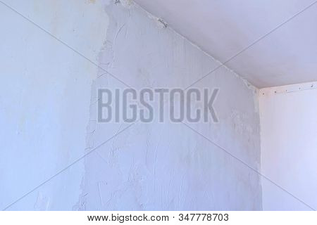 Putty Wall Aligning With Plaster In Room, Renovation Construction Works And Overhaul. Finishing Repa