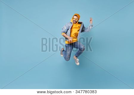 Funny Young Hipster Guy In Fashion Jeans Denim Clothes Posing Isolated On Pastel Blue Background Stu