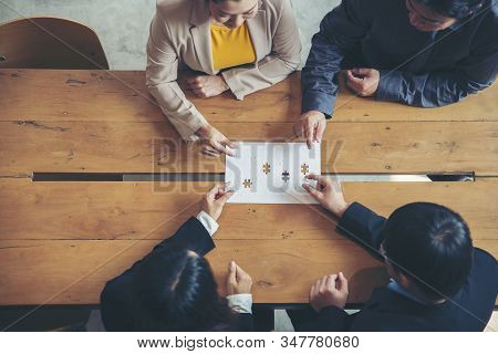 Strategy And Solution Business Concept.group Of Business People Holding Piece Of Jigsaw Puzzle To So