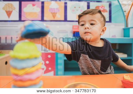 Happy Young Toddler Boy Playing In The Indoor Play Area