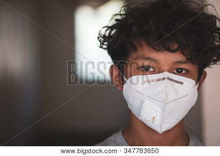 Young Asian Boy Wearing A Protective Mask, Fear Over Flu And Coronavirus