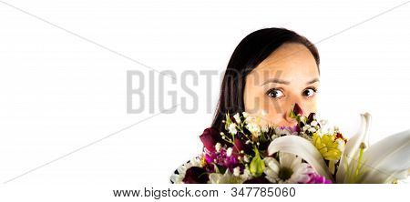 Woman Hides Her Face Behind Basket Of Florets. Womens Hands Holding Colorful Bouquet Of Flowers. Com