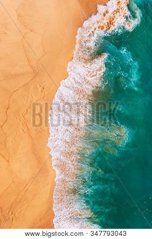 Aerial View Of The Turquoise Ocean Waves On The Beach. Beaches In Australia. Coast As A Background F
