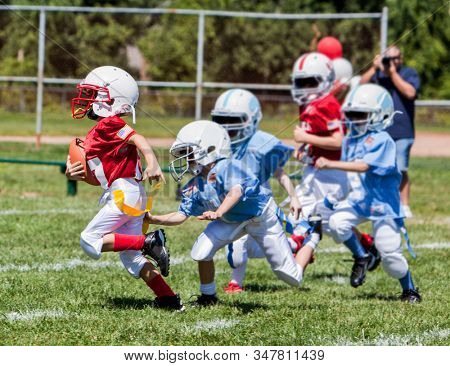 Unidentifiable kids playing American flag football