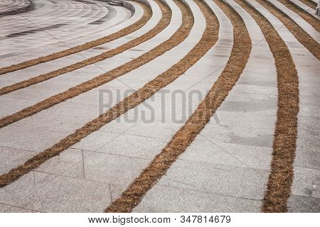 Curved Stone Granite Tiles, Cobblestones Outdoor. Perspective View Of Sidewalk And Stone Road. Marbl
