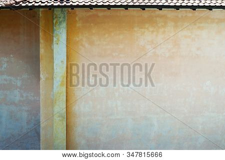 Grunge Color Painted Wall Of Old House.